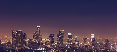 City skyline at night showing sky glow